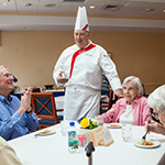 chef talking with seniors
